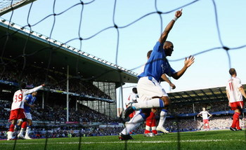 LIVERPOOL, ENGLAND - SEPTEMBER 20:  Sylvain Distin of Everton celebrates as Louis Saha scores the opening goal for their team during the Barclays Premier League match between Everton and Blackburn Rovers at Goodison Park on September 20, 2009 in Liverpool