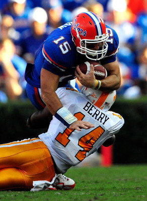 GAINESVILLE, FL - SEPTEMBER 19:  Tim Tebow #15 of the Florida Gators is tackled by Eric Berry #14 of the Tennessee Volunteers during the game at Ben Hill Griffin Stadium on September 19, 2009 in Gainesville, Florida.  (Photo by Sam Greenwood/Getty Images)