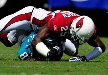 JACKSONVILLE, FL - SEPTEMBER 20:  Bryant McFadden #25 of the Arizona Cardinals tackles Tory Holt #81 of the Jacksonville Jaguars during the game at Jacksonville Municipal Stadium on September 20, 2009 in Jacksonville, Florida.  (Photo by Sam Greenwood/Get