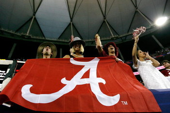 ATLANTA - SEPTEMBER 05:  Fans of the Alabama Crimson Tide cheer against the Virginia Tech Hokies during the Chick-fil-A Kickoff Game at Georgia Dome on September 5, 2009 in Atlanta, Georgia.  (Photo by Kevin C. Cox/Getty Images)
