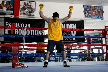 LOS ANGELES, CA - SEPTEMBER 29:Israel Vasquez Two-time Junior Featherweight World Champion stretches before his workout session at Urbina Westside Boxing Gym on September 29, 2009 in Los Angeles, California. Vasquez will return to the ring to face Angel P