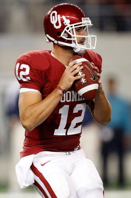 ARLINGTON, TX - SEPTEMBER 05:  Quarterback Landry Jones #12 of the Oklahoma Sooners at Cowboys Stadium on September 5, 2009 in Arlington, Texas.  (Photo by Ronald Martinez/Getty Images)