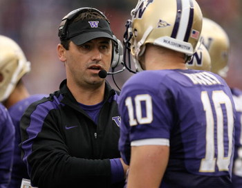 SEATTLE - SEPTEMBER 19:  Head coach Steve Sarkisian of the Washington Huskies talks with quarterback Jake Locker #10 during the game against the USC Trojans on September 19, 2009 at Husky Stadium in Seattle, Washington. The Huskies defeated the Trojans 16