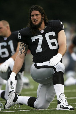 CANTON, OH - AUGUST 06:  Offensive lineman Robert Gallery #76 of the Oakland Raiders stretches prior to taking on the Philadelphia Eagles in the AFC-NFC Pro Football Hall of Fame Game at Fawcett Stadium on August 6, 2006 in Canton, Ohio.  (Photo by Doug B