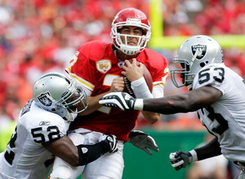 KANSAS CITY, MO - SEPTEMBER 20:  Quarterback Matt Cassel #7 of the Kansas City Chiefs is hit by linebackers Kirk Morrison #52 and Thomas Howard #53 of the Oakland Raiders during the game at Arrowhead Stadium on September 20, 2009 in Kansas City, Missouri.