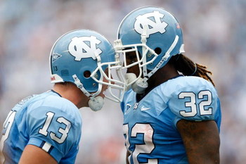CHAPEL HILL, NC - SEPTEMBER 19:  Teammates T.J. Yates #13 and Ryan Houston #32 of the North Carolina Tar Heels celebrate after Houston's touchdown late in the fourth quarter against the East Carolina Pirates at Kenan Stadium on September 19, 2009 in Chape