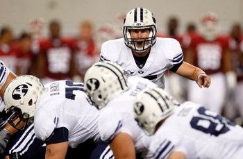 ARLINGTON, TX - SEPTEMBER 05:  Quarterback Max Hall #15 of the Brigham Young Cougars drops back to pass against the Oklahoma Sooners at Cowboys Stadium on September 5, 2009 in Arlington, Texas.  (Photo by Ronald Martinez/Getty Images)