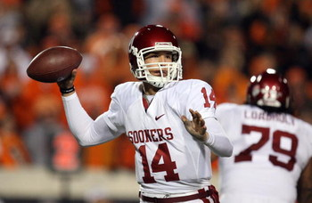STILLWATER, OK - NOVEMBER 29:  Quarterback Sam Bradford #14 of the Oklahoma Sooners drops back to pass against the Oklahoma State Cowboys at Boone Pickens Stadium on November 29, 2008 in Stillwater, Oklahoma.  (Photo by Ronald Martinez/Getty Images)