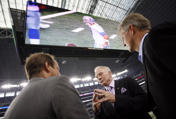 ARLINGTON, TX - AUGUST 21:  Dallas Cowboys team owner Jerry Jones (center) talks with two unidentified individuals prior to a preseason game at Dallas Cowboys Stadium on August 21, 2009 in Arlington, Texas. (Photo by Tom Pennington/Getty Images) 