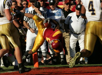 LOS ANGELES, CA - DECEMBER 03:  Reggie Bush #5 of the USC Trojans dives in the endzone for a touchdown against the UCLA Bruins December 3, 2005 at the Los Angeles Memorial Coliseum in Los Angeles, California. USC won 66-19. (Photo by Stephen Dunn/Getty Im