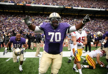 SEATTLE - SEPTEMBER 19:  Offensive guard Morgan Rosborough #70 of the Washington Huskies celebrates as time expires against the USC Trojans on September 19, 2009 at Husky Stadium in Seattle, Washington. The Huskies defeated the Trojans 16-13. (Photo by Ot