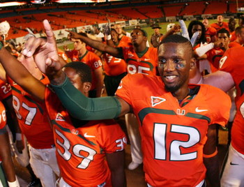 FORT LAUDERDALE, FL - SEPTEMBER 17:  Quarterback Jacory Harris #12 of the Miami Hurricanes celebrates after defeating the Georgia Tech Yellow Jackets at Land Shark Stadium on September 17, 2009 in Fort Lauderdale, Florida. Miami defeated Georgia Tech 33-1