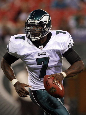 EAST RUTHERFORD, NJ - SEPTEMBER 03:  Michael Vick #7 of the Philadelphia Eagles looks to throw a pass against the New York Jets on September 3, 2009 at Giants Stadium in East Rutherford, New Jersey. The Jets defeated the Eagles 38-27.  (Photo by Jim McIsa