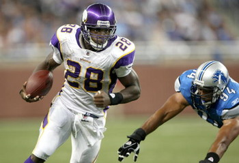 DETROIT - SEPTEMBER 20: Running back Adrian Peterson #28 of the Minnesota Vikings carries the ball past defensive end Coeland Bryan #94 of the Detroit Lions at Ford Field on September 20, 2009 in Detroit, Michigan. The Vikings won 27-13.  (Photo by Stephe