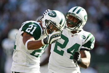 EAST RUTHERFORD, NJ - SEPTEMBER 20: Dwight Lowery #21 of the New York Jets celebrates with teammate Darrelle Revis #24 after a turnover against the New England Patriots at Giants Stadium on September 20, 2009 in East Rutherford, New Jersey.  (Photo by Nic