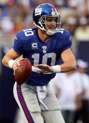EAST RUTHERFORD, NJ - SEPTEMBER 13:  Eli Manning #10 of the New York Giants looks to pass against the Washington Redskins on September 13, 2009 at Giants Stadium in East Rutherford, New Jersey.  (Photo by Jim McIsaac/Getty Images)