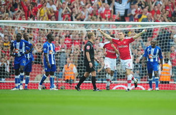 LONDON, ENGLAND - SEPTEMBER 19:  Thomas Vermaelen of Arsenal celebrates his second goal during the Barclays Premier League match between Arsenal and Wigan Athletic at the Emirates Stadium on September 19, 2009 in London, England.  (Photo by Clive Mason/Ge