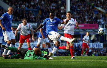 LIVERPOOL, ENGLAND - SEPTEMBER 20:  Joseph Yobo of Everton clears a dangerous ball as his keeper Tim Howard watches on during the Barclays Premier League match between Everton and Blackburn Rovers at Goodison Park on September 20, 2009 in Liverpool, Engla