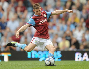 BIRMINGHAM, ENGLAND - SEPTEMBER 19:  James Milner of Aston Villa scores from the spot during the Barclays Premier League match between Aston Villa and Portsmouth at Villa Park on September 19, 2009 in Birmingham, England.  (Photo by Laurence Griffiths/Get