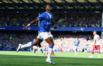LIVERPOOL, ENGLAND - SEPTEMBER 20:  Louis Saha of Everton celebrates after scoring the opening goal of the Barclays Premier League match between Everton and Blackburn Rovers at Goodison Park on September 20, 2009 in Liverpool, England.  (Photo by Clive Br