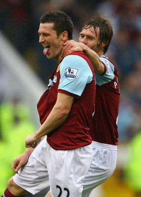 BURNLEY, ENGLAND - SEPTEMBER 19:  David Nugent of Burnley celebrates with Graham Alexander after scoring his second goal during the Barclays Premier League match between Burnley and Sunderland at Turf Moor on September 19, 2009 in Burnley, England.  (Phot