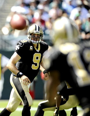 PHILADELPHIA - SEPTEMBER 20:  Drew Brees #9 of the New Orleans Saints looks for an open man during a game against the Philadelphia Eagles at Lincoln Financial Field on September 20, 2009 in Philadelphia, Pennsylvania.  (Photo by Jeff Zelevansky/Getty Imag