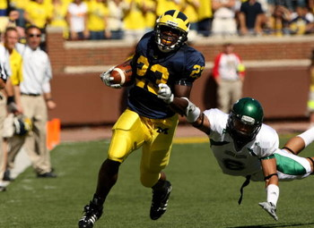 ANN ARBOR, MI - SEPTEMBER 19:  Running back Carlos Brown #23 of the Michigan Wolverines carries the ball for a 30 yard gain in the first quarter past safety Marty Caldwell #6 of the Eastern Michigan Eagles at Michigan Stadium on September 19, 2009 in Ann