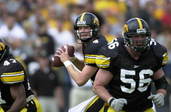 IOWA CITY, IOWA - SEPTEMBER 29:  Quarterback Kyle McCann #4 of the Iowa Hawkeyes prepares to throw against the Penn State Nittany Lions during the game at Kinnick Stadium in Iowa City, Iowa on September 29, 2001.  Iowa defeated Penn State 24-18.  (Photo b