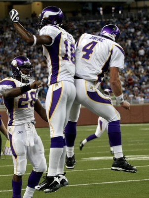 DETROIT - SEPTEMBER 20:  Quarterback Brett Favre #4 of the Minnesota Vikings celebrates with Sidney Rice #18 and Adrian Peterson #2 after throwing a touchdown pass in the second quarter against the Detroit Lions at Ford Field on September 20, 2009 in Detr