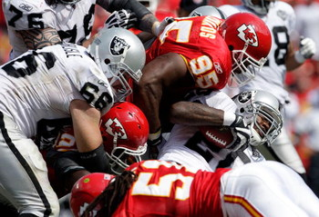 KANSAS CITY, MO - SEPTEMBER 20:  Darren McFadden #20 of the Oakland Raiders runs up the middle as Ron Edwards #95 of the Kansas City Chiefs defends during the game at Arrowhead Stadium on September 20, 2009 in Kansas City, Missouri.  (Photo by Jamie Squir
