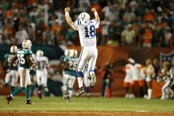 MIAMI - SEPTEMBER 21:  Quarterback Peyton Manning #18 of the Indianapolis Colts celebrates after throwing the game-winning touchdown pass in the fourth quarter against the Miami Dolphins at Land Shark Stadium on September 21, 2009 in Miami, Florida. The C