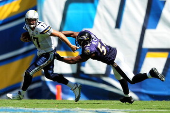 SAN DIEGO - SEPTEMBER 20: Philip Rivers #17 of the San Diego Chargers runs away from Ray Lewis #52 of the Baltimore Ravens at Qualcomm Stadium on September 20, 2009 in San Diego, California.  (Photo by Jacob de Golish/Getty Images)