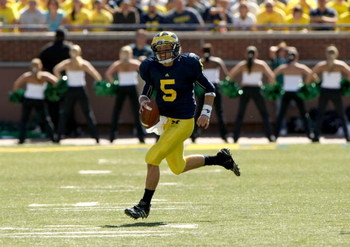 ANN ARBOR, MI - SEPTEMBER 19:  Quarterback Tate Forcier #5 of the Michigan Wolverines carries the ball against the Eastern Michigan Eagles at Michigan Stadium on September 19, 2009 in Ann Arbor, Michigan.   Michigan won 45-17.  (Photo by Stephen Dunn/Gett