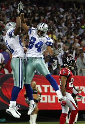ATLANTA - DECEMBER 16:  Wide receiver Terrell Owens #81 of the Dallas Cowboys celebrates his second touchdown with Patrick Crayton #84 during play against the Atlanta Falcons at the Georgia Dome on December 16, 2006 in Atlanta, Georgia.  (Photo by Ronald