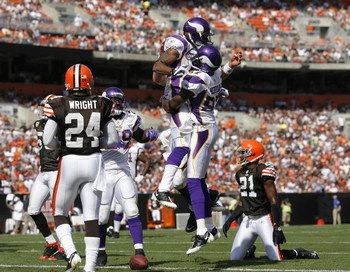 CLEVELAND - SEPTEMBER 13:  Percy Harvin #12 of the Minnesota Vikings celebrates with Bernard Berrian #87 after scoring a touchdown against the Cleveland Browns at Cleveland Browns Stadium on September 13, 2009 in Cleveland, Ohio.  (Photo by Matt Sullivan/