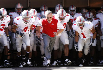 CLEVELAND - SEPTEMBER 19: Head coach Jim Tressel of the Ohio State Buckeyes leads his team onto the field prior to playing the Toledeo Rockets on September 19, 2009 at Cleveland Browns Stadium in Cleveland, Ohio.  (Photo by Gregory Shamus/Getty Images)
