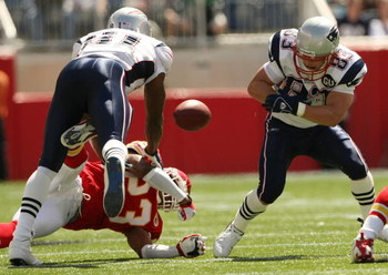 FOXBORO, MA - SEPTEMBER 7:  Wes Welker #83 of the New England Patriots fumbles the ball as teammate Randy Moss #81 blocks Patrick Surtain #23 of the Kansas City Chiefs at Gillette Stadium September 7, 2008 in Foxboro, Massachusetts. The Chiefs recovered t