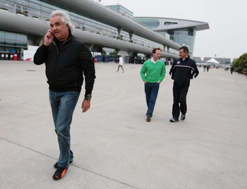 SHANGHAI, CHINA - APRIL 16:  (L-R) Renault Team Principal Flavio Briatore, Red Bull Racing Team Principal Christian Horner and BMW Sauber Team Principal Mario Theissen walk in the paddock during previews to the Chinese Formula One Grand Prix at the Shangh