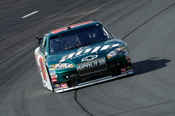 LOUDON, NH - SEPTEMBER 18:  Dale Earnhardt Jr., driver of the #88 AMP Energy/National Guard Chevrolet, rounds turn two during practice for the NASCAR Sprint Cup Series Sylvania 300 at the New Hampshire Motor Speedway on September 18, 2009 in Loudon, New H