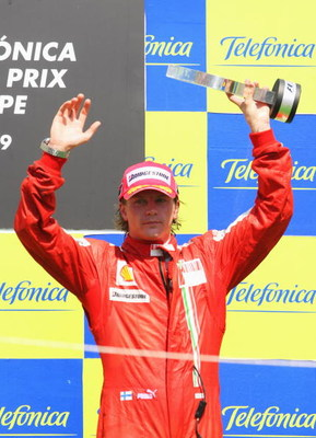 VALENCIA, SPAIN - AUGUST 23:  Kimi Raikkonen of Finland and Ferrari celebrates on the podium after finishing third in the European Formula One Grand Prix at the Valencia Street Circuit on August 23, 2009, in Valencia, Spain.  (Photo by Mark Thompson/Getty