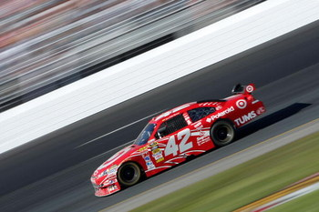 LOUDON, NH - SEPTEMBER 20:  Juan Pablo Montoya, driver of the #42 Target Chevrolet, rounds turn four during the NASCAR Sprint Cup Series Sylvania 300 at the New Hampshire Motor Speedway on September 20, 2009 in Loudon, New Hampshire.  (Photo by Elsa/Getty