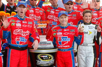 LOUDON, NH - SEPTEMBER 20:  Mark Martin, driver of the #5 CARQUEST/Kellogg's Chevrolet, celebrates with the trophy in victory lane after winning the NASCAR Sprint Cup Series Sylvania 300 at the New Hampshire Motor Speedway on September 20, 2009 in Loudon,