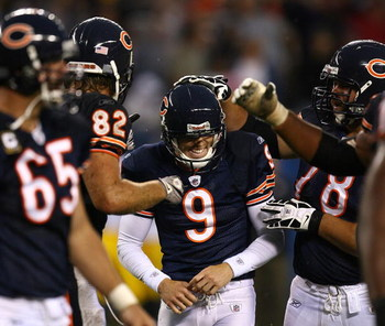 CHICAGO - SEPTEMBER 20: Robbie Gould #9 of the Chicago Bears smiles as teammates including Greg Olsen #82 and Kevin Shaffer #78 congratulate him for kicking the game-winning field goal againstof the Pittsburgh Steelers on September 20, 2009 at Soldier Fie
