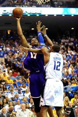 ORLANDO, FL - JUNE 14:  Andrew Bynum #17 of the Los Angeles Lakers goes up for a shot over Dwight Howard #12 of the Orlando Magic in the second quarter of Game Five of the 2009 NBA Finals on June 14, 2009 at Amway Arena in Orlando, Florida.  NOTE TO USER: