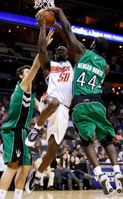 CHARLOTTE, NC - MARCH 16:  Pops Mensah-Bonsu #44 of the Toronto Raptors tries to block Emeka Okafor #50 of the Charlotte Bobcats during their game at Time Warner Cable Arena on March 16, 2009 in Charlotte, North Carolina.  NOTE TO USER: User expressly ack