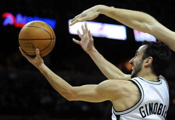 SAN ANTONIO - JANUARY 31:  Guard Manu Ginobili #20 of the San Antonio Spurs takes a shot against the New Orleans Hornets on January 31, 2009 at AT&T Center in San Antonio, Texas.  NOTE TO USER: User expressly acknowledges and agrees that, by downloading a