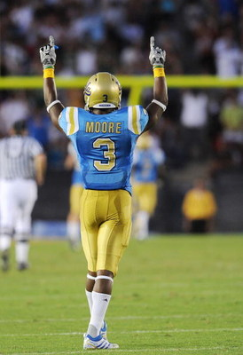 PASADENA, CA - SEPTEMBER 05:  Rahim Moore #3 of the UCLA Bruins celebrates during the game against the San Diego State Aztecs at the Rose Bowl on September 5, 2009 in Pasadena, California.  (Photo by Lisa Blumenfeld/Getty Images)