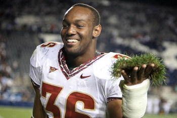 PROVO, UT. - SEPTEMBER 19:  Dekoda Watson #36 of the Florida State Seminoles holds a piece of sod from the field to add to the sod cemetery after a win over the Brigham Young Cougars at La Vell Edwards Stadium on September 19, 2009 in Provo, Utah.  (Photo