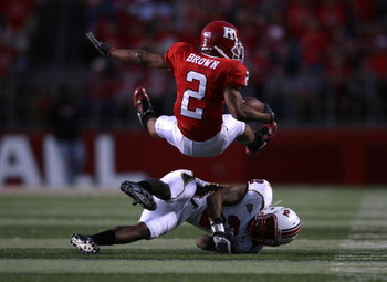 PISCATAWAY, NJ - SEPTEMBER 29:  Tim Brown #2 of the Rutgers Scarlet Knights is tackled by Kevin Barnes #2 of the Maryland Terrapins during their game at Rutgers Stadium on September 29, 2007 in Piscataway, New Jersey.  (Photo by Nick Laham/Getty Images)