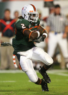 MIAMI - NOVEMBER 13: Running back Graig Cooper #2 of the Miami Hurricanes looks for room to run while taking on the Virginia Tech Hokies at Dolphin Stadium on November 13, 2008 in Miami, Florida.  (Photo by Doug Benc/Getty Images)